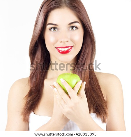 Portrait of beauty smiling woman holding green apple. Healthy diet and nutrition. Smile with white teeth. - stock photo