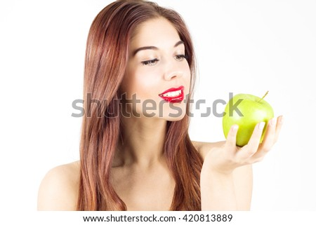 Portrait of beauty smiling woman looking at green apple. Healthy diet and nutrition. Smile with white teeth. - stock photo