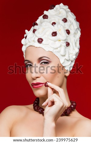 Portrait of beauty with sweet tart and cherry on top - stock photo