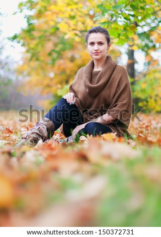 Portrait of beauty woman in autumn park  - stock photo