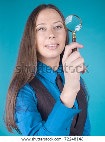 portrait of beauty woman with lens looking in, on blue background
