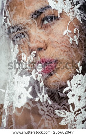 portrait of beauty young afro woman through white lace, like new bride under veil close up - stock photo