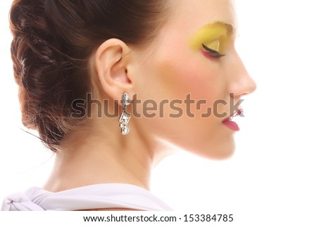 Portrait of beauty young girl with bright multicolored make-up.  - stock photo