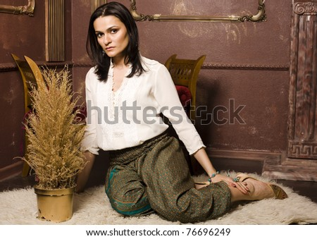 portrait of beauty young woman in luxury interior
