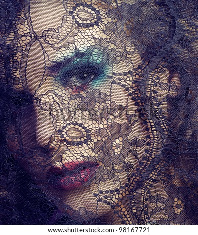 portrait of beauty young woman through lace - stock photo