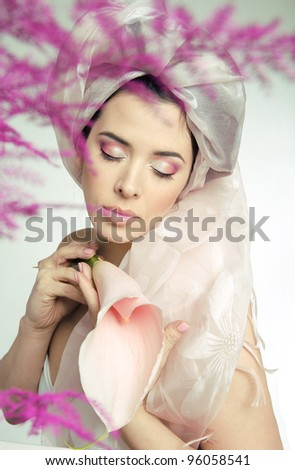 portrait of beauty young woman with flower close up