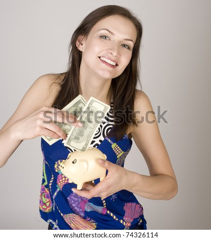 portrait of beauty young woman with piggy bank and money