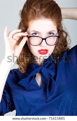portrait of beauty young woman with red hairs, in fashion eyeglasses