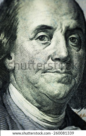 Portrait of Benjamin Franklin close-up from one hundred dollars bill - stock photo