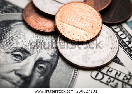 Portrait of Benjamin Franklin close-up shots in macro lens from one hundred dollars banknote and coins cents - stock photo