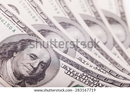 Portrait of Benjamin Franklin from one hundred dollars bill new edition closeup conceptual background. Business concept. Selective focus, blurred background - stock photo