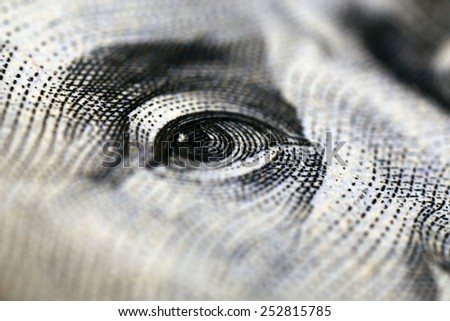 Portrait of Benjamin Franklin on hundred dollar banknote, macro view - stock photo