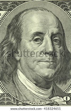 Portrait of Benjamin Franklin on the banknote in a hundred American dollars closeup