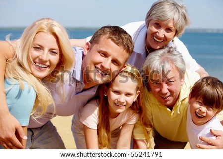 Portrait of big happy family looking at camera - stock photo