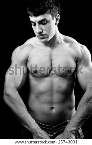Portrait of big muscular sexy young bodybuilder - stock photo