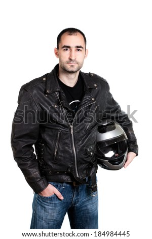 Portrait of biker holding a helmet - stock photo