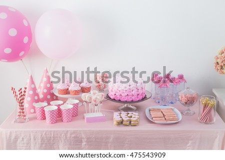 portrait of birthday party supplies. sweet corner with cake, lollies, cookies and candy