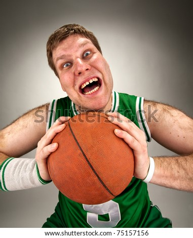 Portrait of bizarre basketball player with ball - stock photo