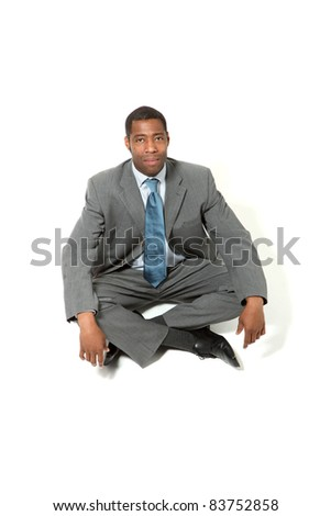 portrait of black businessman sitting on the floor