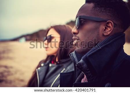 Portrait of black man and caucasian woman. - stock photo