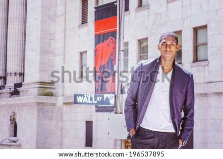 Portrait of Black Teenage Boy. Wearing a white under wear, fashionable jacket, two   hands in pockets, a young black college student is standing on Wall Street, hopefully looking at you. - stock photo