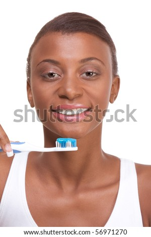 Portrait of black woman holding toothbrush with blue toothpaste and smiling - stock photo
