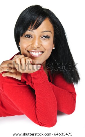 Portrait of black woman smiling laying isolated on white background - stock photo