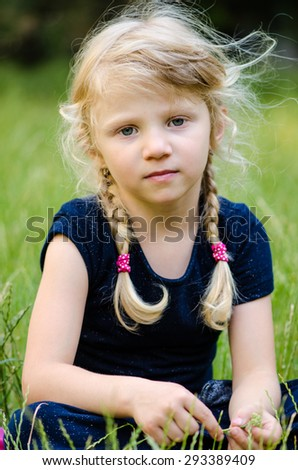 portrait of blond girl with braided hair - stock photo