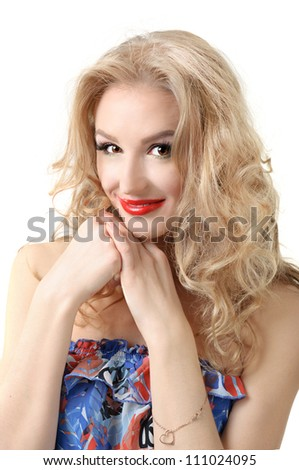 Portrait of blond long hair girl in colorful dress - stock photo
