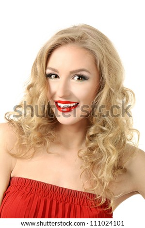 Portrait of blond long hair girl in red dress - stock photo