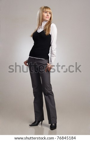 Portrait of blond sexy woman in suit - stock photo
