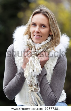 portrait of blond woman outdoor in autumn - stock photo
