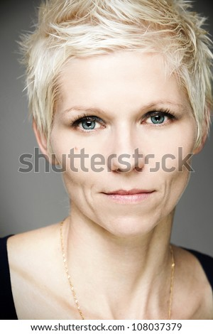 Portrait of blond woman with blue contact lenses