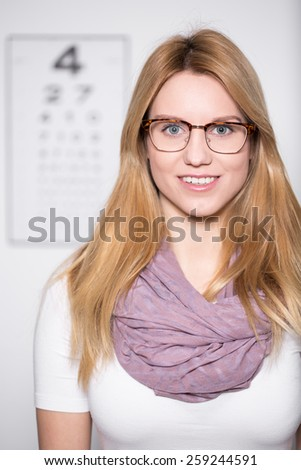 Portrait of blonde attractive girl wearing glasses - stock photo
