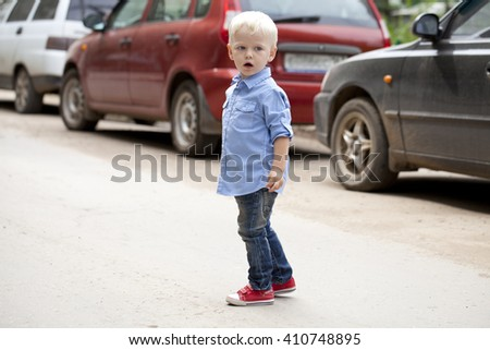 Portrait of blonde baby boy in summer park - stock photo