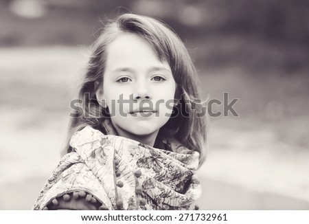 portrait of blonde girl outdoors in spring time - stock photo