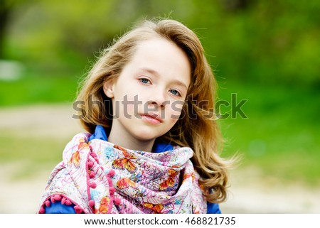 portrait of blonde girl outdoors in spring time