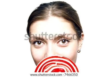 Portrait of blonde holding big lollipop - stock photo