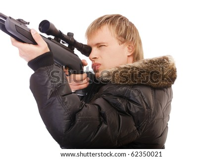 portrait of blonde man with scoped rifle aiming