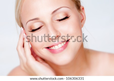 Portrait of blonde with the ideal skin, isolated on a white background - stock photo