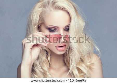 Portrait of blonde young sexy woman. Studio shot. Glamour makeup. - stock photo