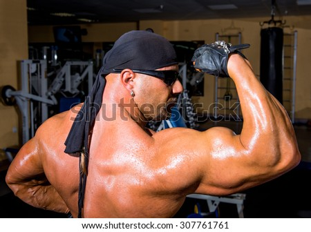 Portrait of bodybuilder in the gym - stock photo