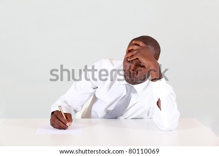 Portrait of bored businessman in office - stock photo