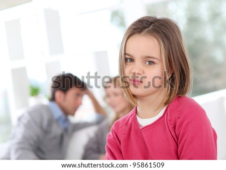 Portrait of bored little girl at home - stock photo