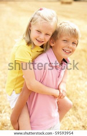 Portrait Of Boy And Girl In Summer Harvested Field - stock photo