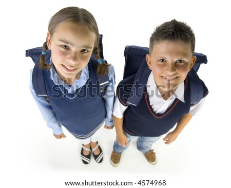 Portrait of boy and girl. They're looking at camera and smiling. Isolated on white in studio, high angle view - stock photo