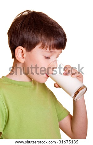 Portrait of boy drinking glass of milk - stock photo