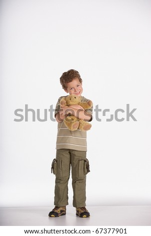 Portrait of boy hugging teddy bear - stock photo
