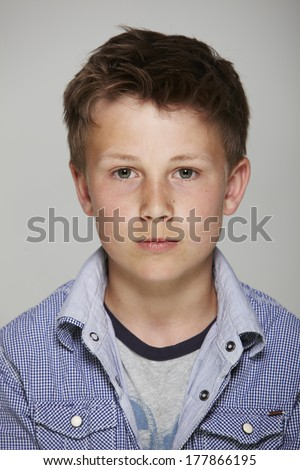 Portrait of boy in studio - stock photo