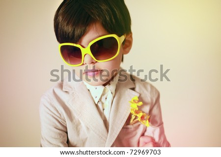 Portrait of boy in yellow  glasses. Retro style